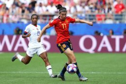 REIMS, FRANCE - JUNE 24:  Lucia Garcia of Spain evades Crystal Dunn of the USA during the 2019 FIFA Women's World Cup France Round Of 16 match between Spain and USA at Stade Auguste Delaune on June 24, 2019 in Reims, France. (Photo by Robert Cianflone/Getty Images)