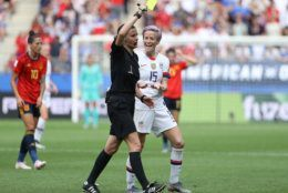 REIMS, FRANCE - JUNE 24: Megan Rapinoe of the USA reacts to referee Katalin Kulcsar as she shows a yellow card during the 2019 FIFA Women's World Cup France Round Of 16 match between Spain and USA at Stade Auguste Delaune on June 24, 2019 in Reims, France. (Photo by Robert Cianflone/Getty Images)