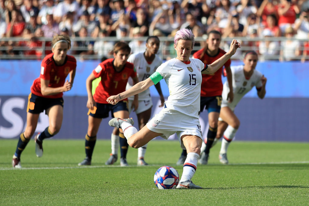 REIMS, FRANCE - JUNE 24: Megan Rapinoe of the USA scores her team's second goal from the penalty spot during the 2019 FIFA Women's World Cup France Round Of 16 match between Spain and USA at Stade Auguste Delaune on June 24, 2019 in Reims, France. (Photo by Marc Atkins/Getty Images)