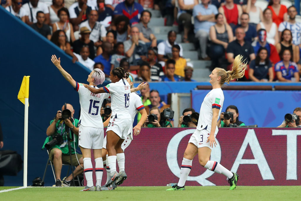 PARIS, FRANCE - JUNE 28:  Megan Rapinoe of the USA celebrates with teammates after scoring her team's first goal during the 2019 FIFA Women's World Cup France Quarter Final match between France and USA at Parc des Princes on June 28, 2019 in Paris, France. (Photo by Richard Heathcote/Getty Images)