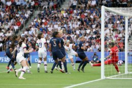 PARIS, FRANCE - JUNE 28:  Megan Rapinoe of the USA (not in frame) scores her team's first goal during the 2019 FIFA Women's World Cup France Quarter Final match between France and USA at Parc des Princes on June 28, 2019 in Paris, France. (Photo by Alex Grimm/Getty Images)