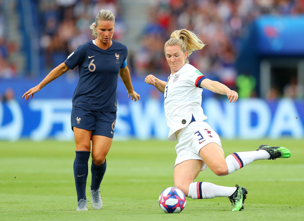 PARIS, FRANCE - JUNE 28:  Samantha Mewis of the USA is put under pressure by Amandine Henry of France during the 2019 FIFA Women's World Cup France Quarter Final match between France and USA at Parc des Princes on June 28, 2019 in Paris, France. (Photo by Richard Heathcote/Getty Images)