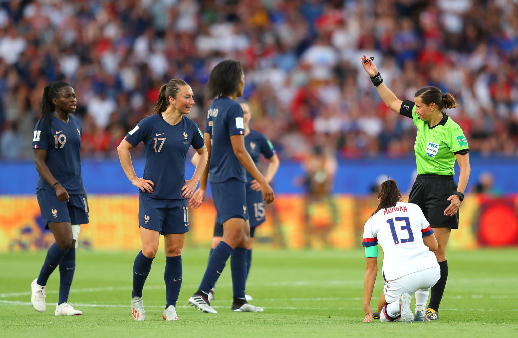 PARIS, FRANCE - JUNE 28:  Referee Maryna Striletska talks to Griedge Mbock Bathy of France following a foul on Alex Morgan of USA during the 2019 FIFA Women's World Cup France Quarter Final match between France and USA at Parc des Princes on June 28, 2019 in Paris, France. (Photo by Richard Heathcote/Getty Images)
