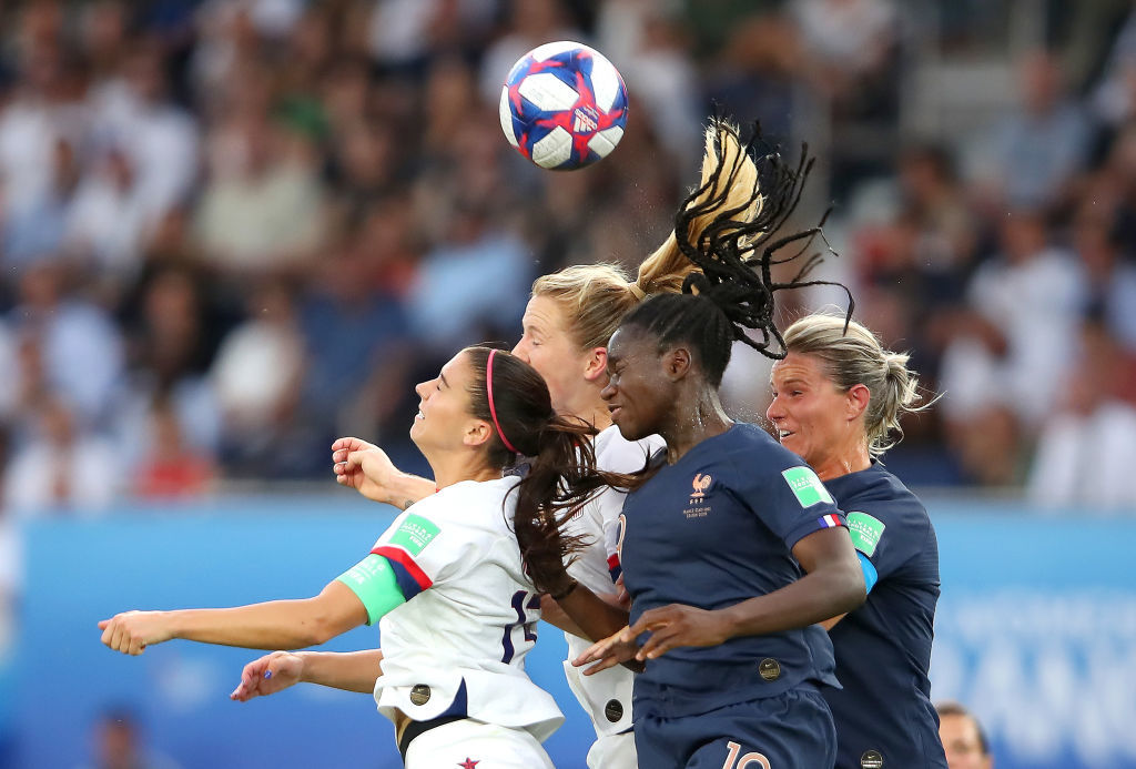 PARIS, FRANCE - JUNE 28:  Alex Morgan of the USA jumps for the ball with Griedge Mbock Bathy of France during the 2019 FIFA Women's World Cup France Quarter Final match between France and USA at Parc des Princes on June 28, 2019 in Paris, France. (Photo by Alex Grimm/Getty Images)
