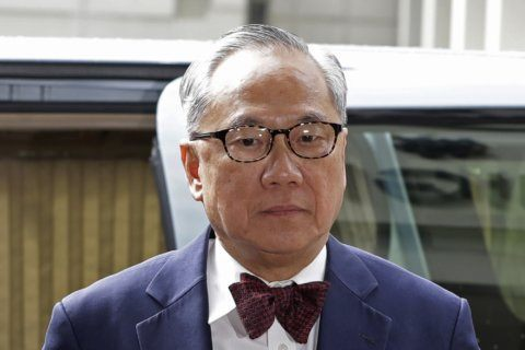 Hong Kong court throws out ex-leader's misconduct conviction