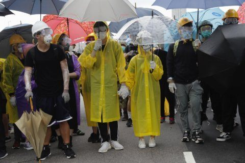 The Latest: Hong Kong leader condemns protest in legislature