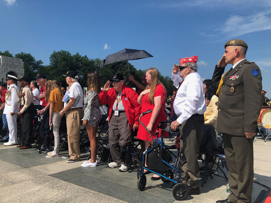 Veterans and onlookers gathered at the World War II Memorial to mark D-Day's 75th anniversary Thursday. (WTOP/John Aaron)