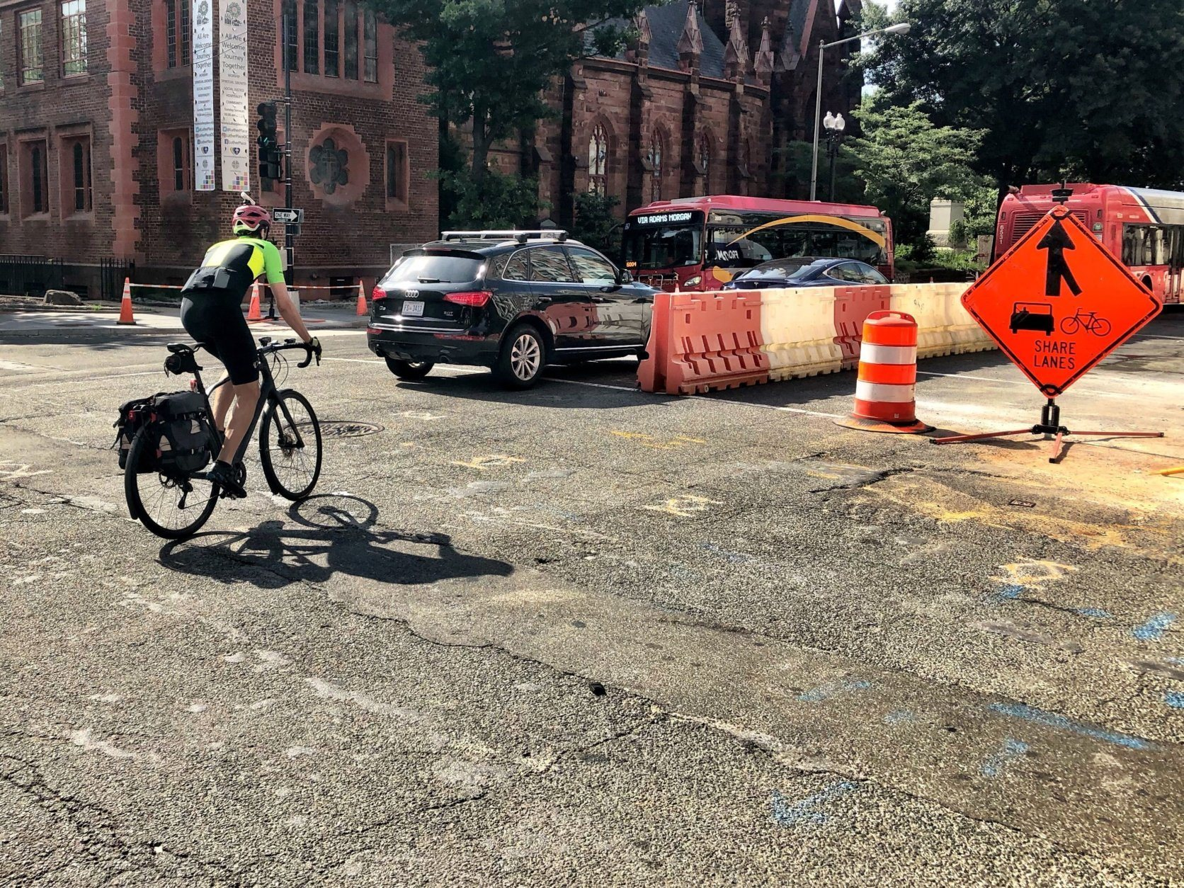 "Despite ongoing construction, lane shifts, and limited visibility, bike commuter Drew Stuyvenberg said ""it's a short term headache, for some long term gain,"" -- protected bike lanes. (WTOP/Neal Augenstein)"