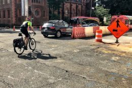 """Despite ongoing construction, lane shifts, and limited visibility, bike commuter Drew Stuyvenberg said """"it's a short term headache, for some long term gain,"""" -- protected bike lanes. (WTOP/Neal Augenstein)"""