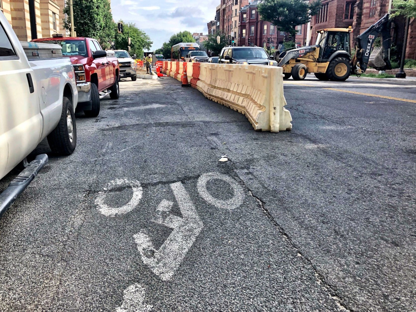 Demarcated bike lanes are painted on 14th Street, but bike commuters say drivers often park in them. (WTOP/Neal Augenstein)
