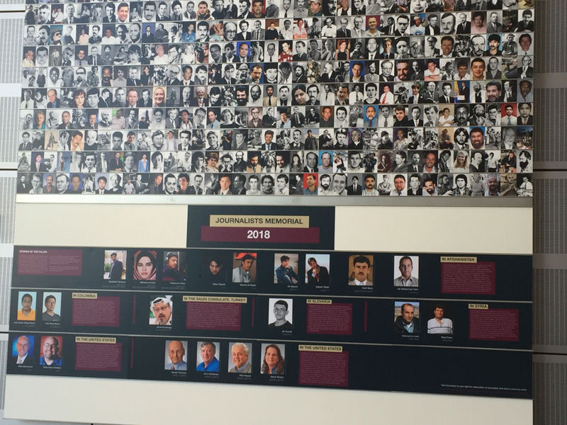 The names of 21 journalists who were killed in the past year were added to the Newseum's memorial wall on Monday. (WTOP/John Domen)