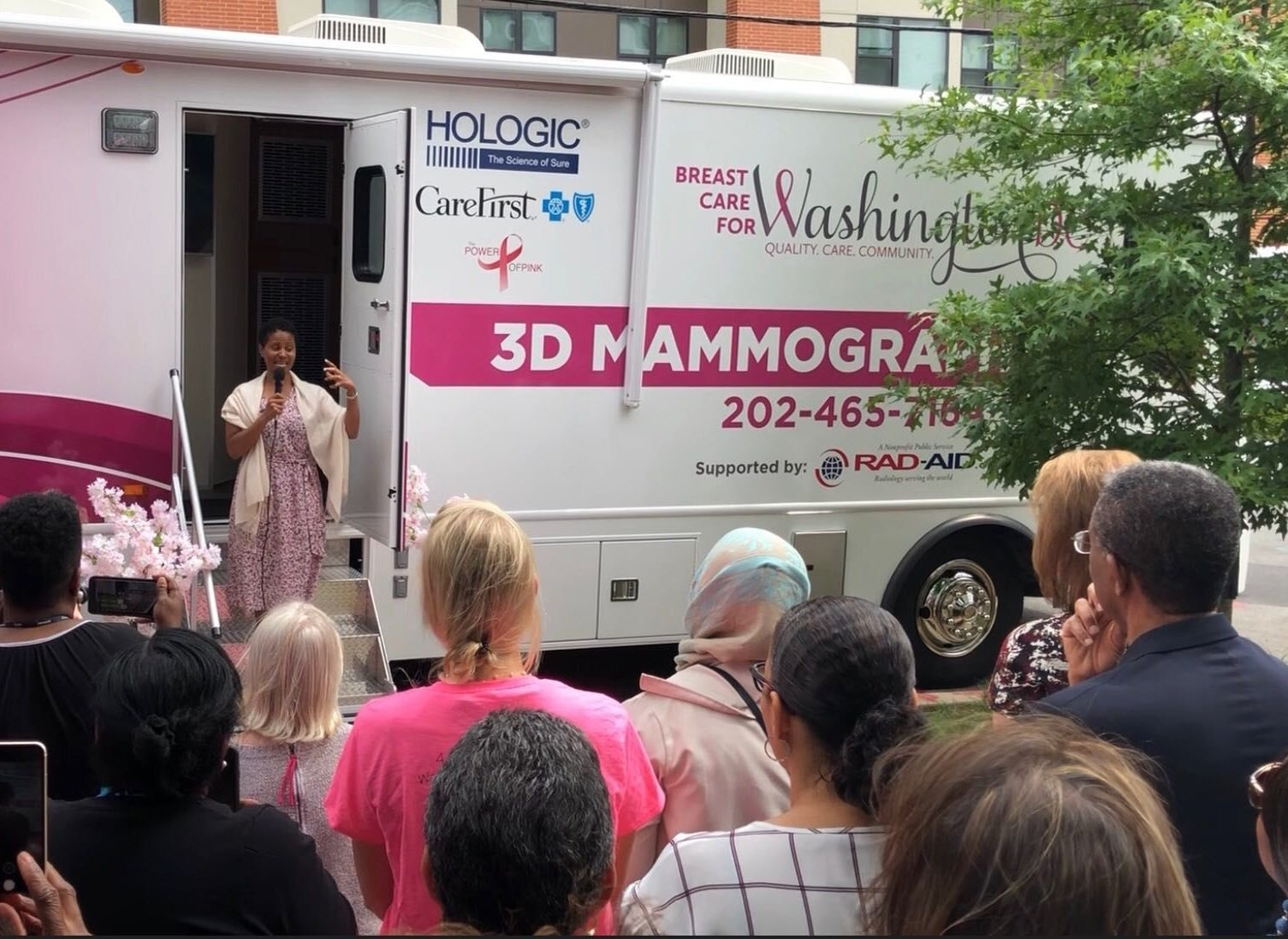"""""""Everyone doesn't have the resources to have a private doctor,"""" six month breast cancer survivor Erica Walls said at the MobileMammo ribbon cutting. """"They're bringing it to the community and broadening and leveling the playing field for something that's basically a human right — health care."""" (WTOP/Kristi King)"""