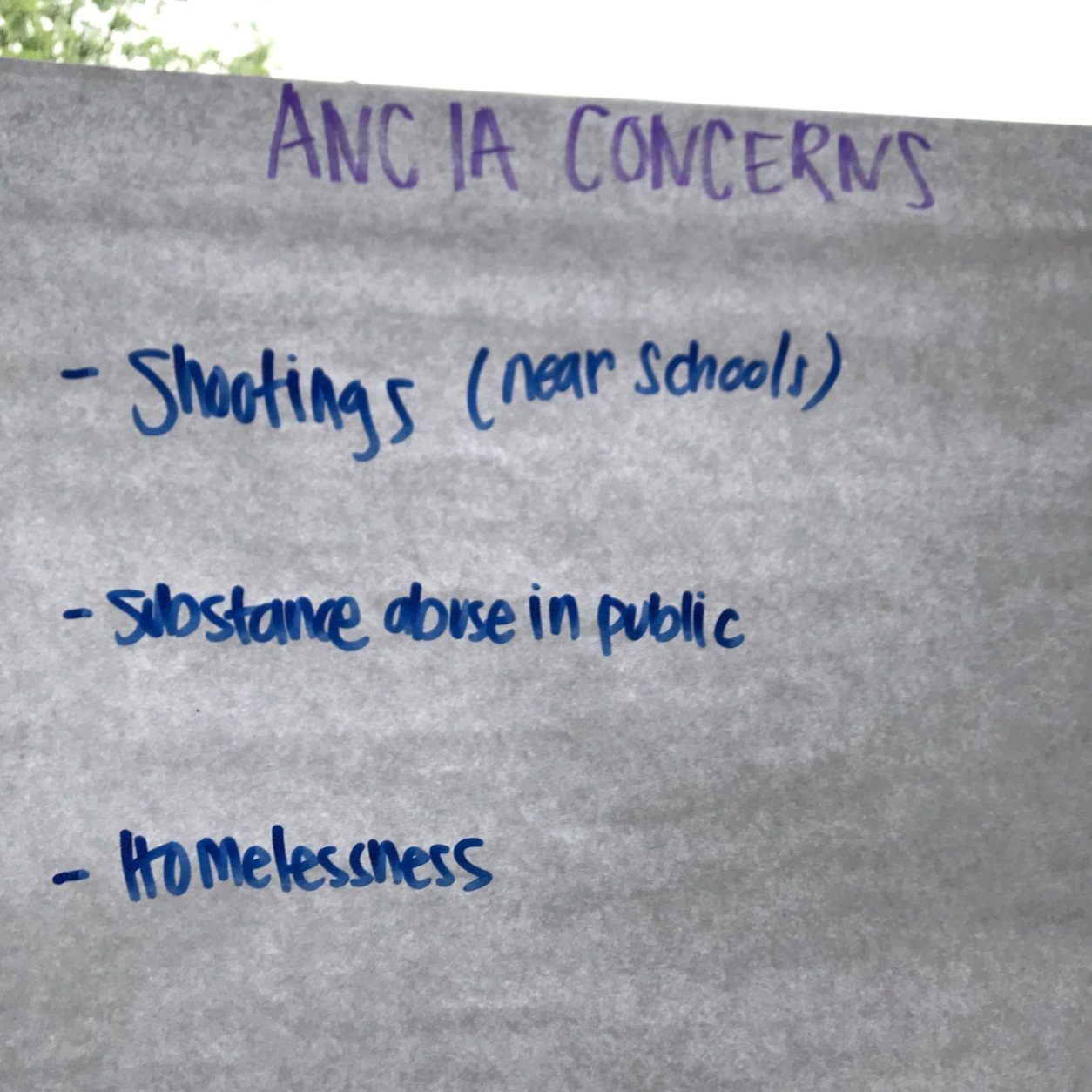 A poster taped to the window spells out the community's top three concerns. (WTOP/Dick Uliano)