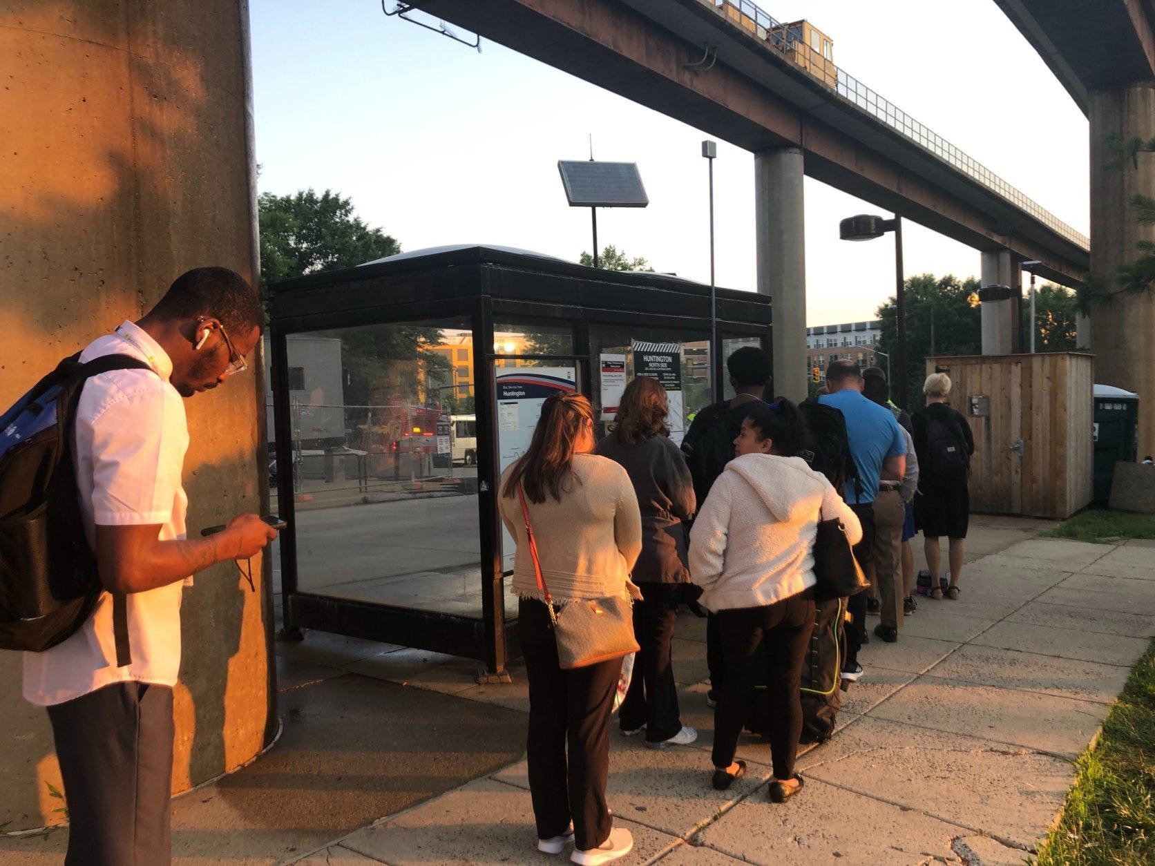 Metro riders wait for a shuttle to arrive June 3, 2019. (WTOP/Melissa Howell)