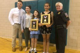 Their bravery was honored Tuesday with the highest school safety patrol honor, the Lifesaving Medal, presented by AAA. (WTOP/Melissa Howell)