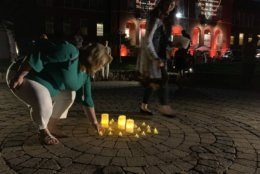 Following a memorial concert, candlelight vigil outside the Maryland Hall, in honor of the five victims of the Capital Gazette shooting. (WTOP/Mike Murillo)