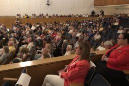 Family, friends and community members packed into the Maryland Hall in Annapolis Friday night to remember the five Capital Gazette employees who died after a gunman opened fire in their newsroom exactly one year ago. (WTOP/Mike Murillo)