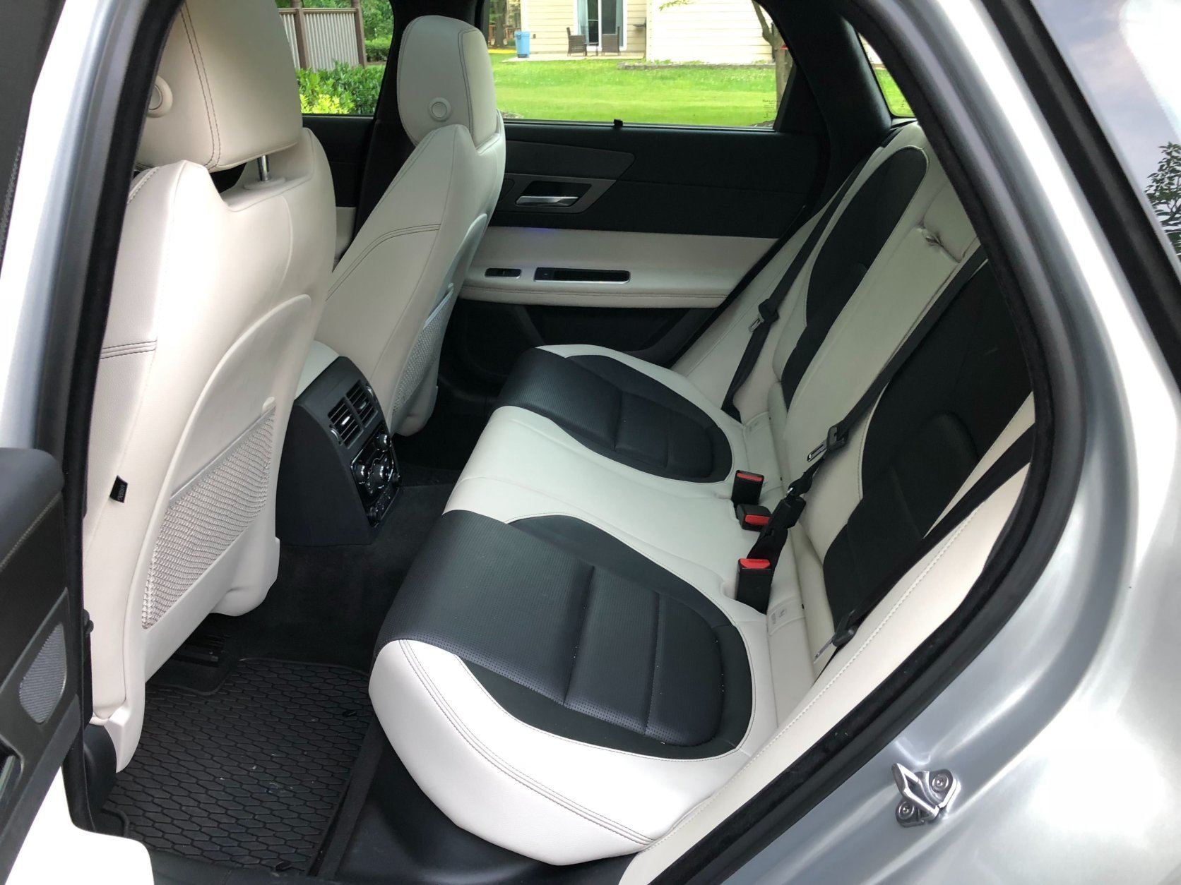 The interior color of the Jaguar XF Sportbrake is different — a light Oyster color with Ebony inserts on the seats and door panels that WTOP Car Reviewer Mike Parris says work very well together. (WTOP/Mike Parris )