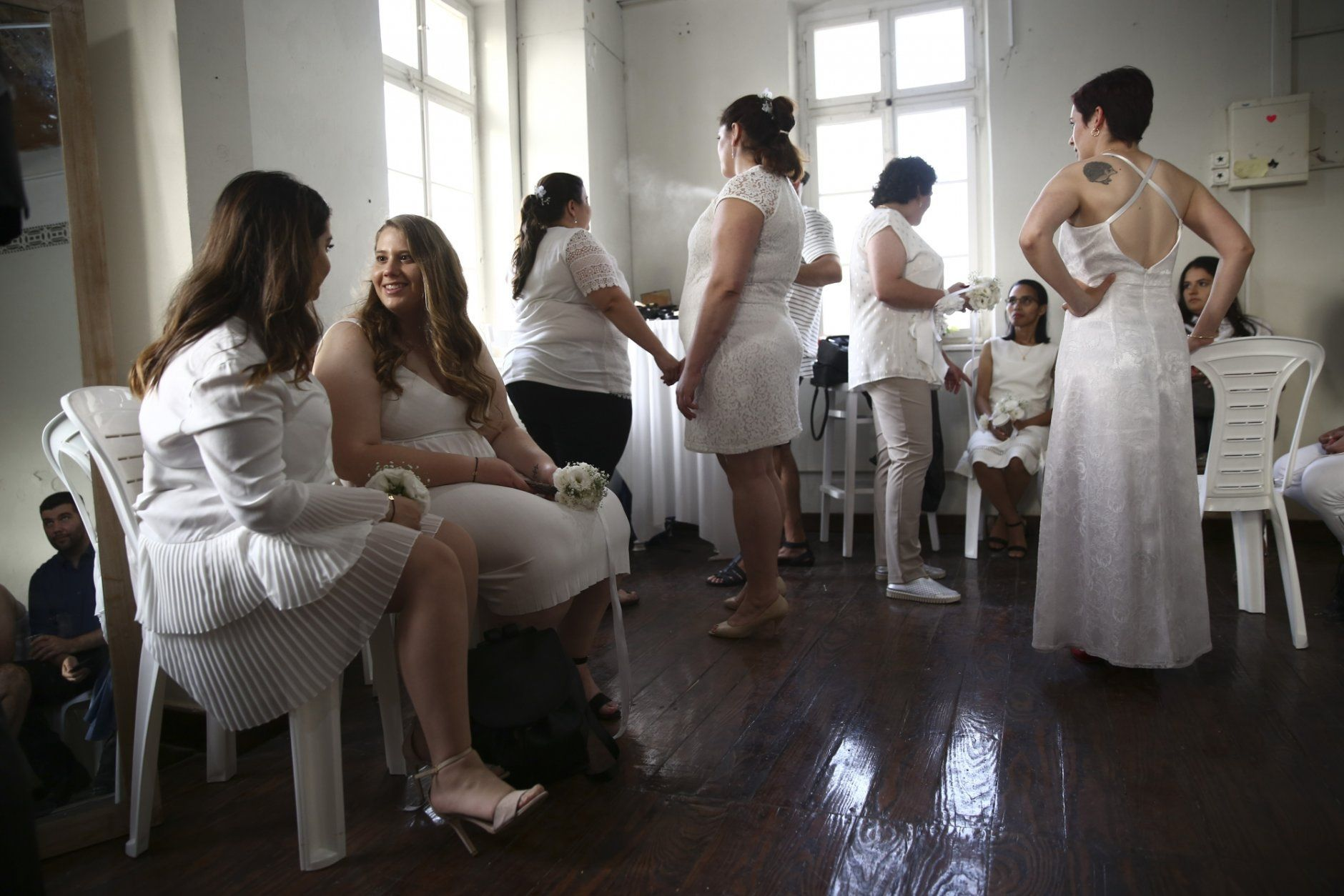 Gay couples prepare for a mass same-sex wedding in Tel Aviv, Israel, Tuesday, June 4, 2019. Hundreds of Israelis have participated in a mass wedding in Tel Aviv to demand the right to same-sex marriage ahead of the country's Gay Pride week, which involved an unofficial wedding ceremony for 23 gay couples, (AP Photo/Oded Balilty)