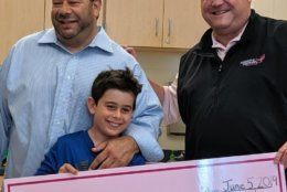 From left, Aaron Goldberg, son Joey, and Michael Jessup of the Susan G. Komen Foundation, gather at Beverly Farms Elementary to surprise Joey who raised $1,300 for cancer research. (Courtesy Aaron Goldberg)