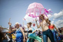 Parade attendees in costume make their way along Surf Avenue during the 37th annual Mermaid Parade at Coney Island, Saturday, June 22, 2019 in New York. (AP Photo/Eduardo Munoz Alvarez)
