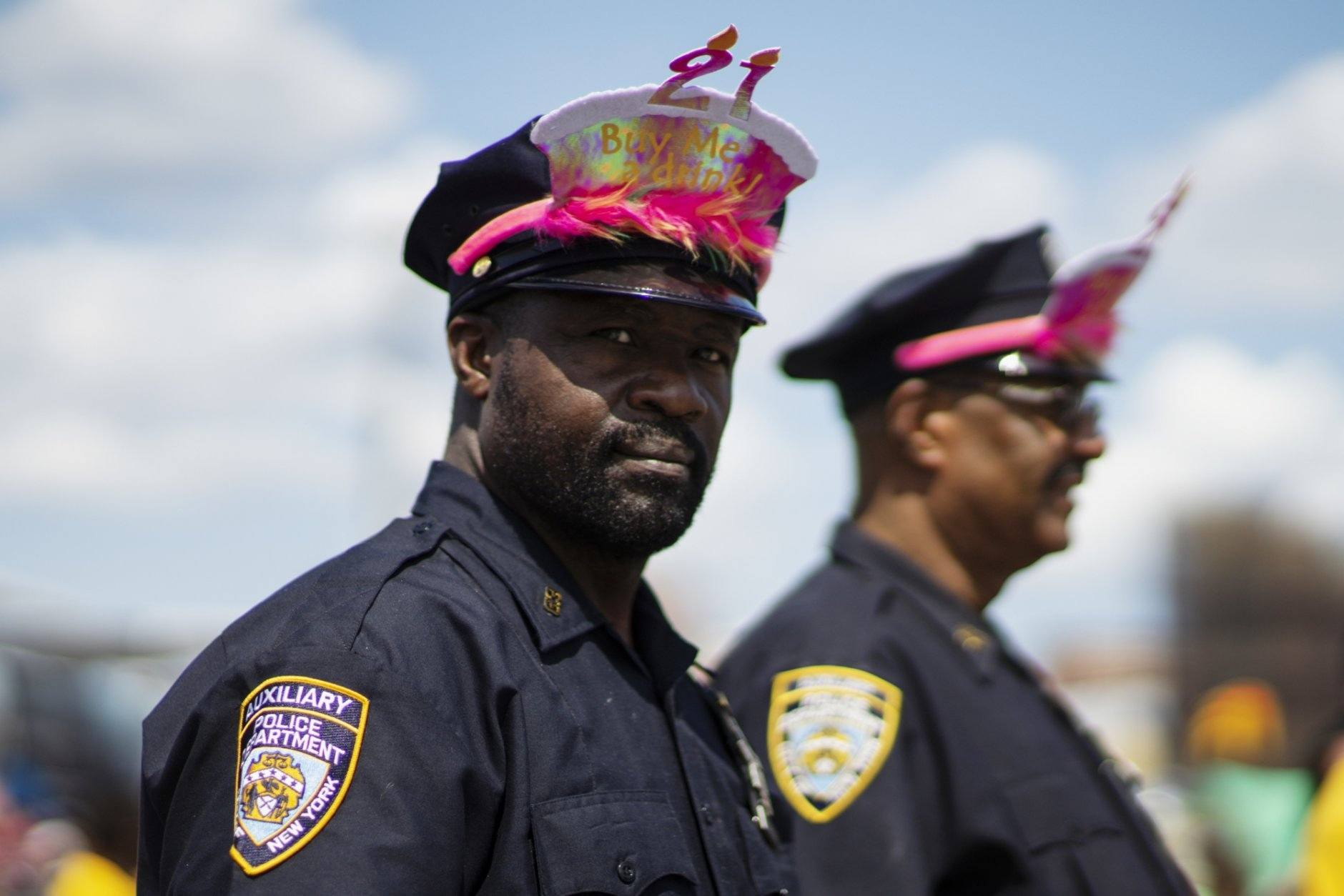 NYPD officers stand guard as as parade attendees in costume make their way along Surf Avenue during the 37th annual Mermaid Parade at Coney Island, Saturday, June 22, 2019 in New York. (AP Photo/Eduardo Munoz Alvarez)