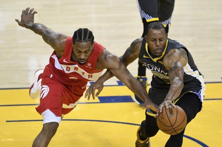 ac5fd43000d Toronto Raptors forward Kawhi Leonard, left, and Golden State Warriors  forward Andre Iguodala reach for the ball during the first half of Game 6  of ...