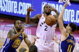 Toronto Raptors forward Kawhi Leonard (2) loses the ball under pressure from Golden State Warriors guard Klay Thompson (11) and teammate Andre Iguodala (9) during the second half of Game 2 of basketball's NBA Finals, Sunday, June 2, 2019, in Toronto. (Frank Gunn/The Canadian Press via AP)