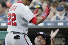 Washington Nationals' Juan Soto (22) is congratulated by pitching coach Paul Menhart after hitting a solo home run against the Detroit Tigers during the second inning of a baseball game, Friday, June 28, 2019, in Detroit. (AP Photo/Duane Burleson)