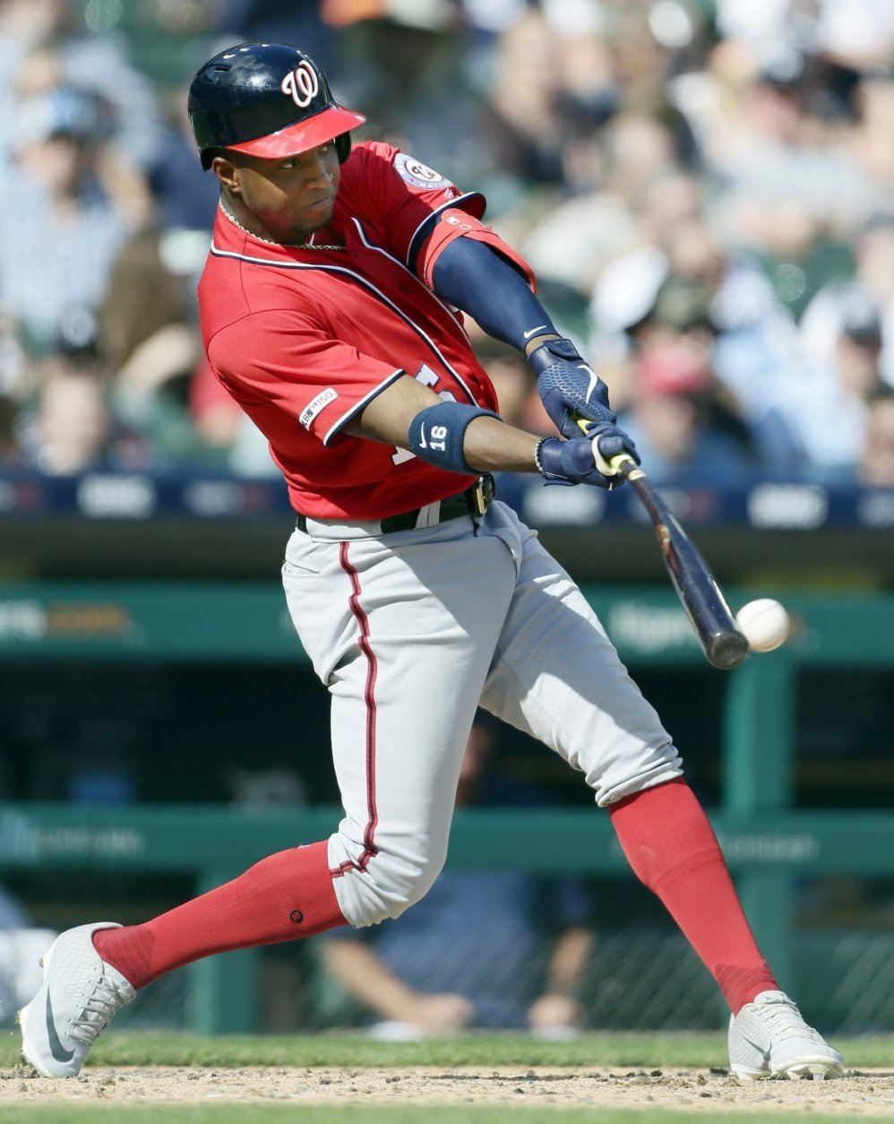 Washington Nationals' Victor Robles singles to drive in Brian Dozier during the fourth inning of a baseball game against the Detroit Tigers, Saturday, June 29, 2019, in Detroit. (AP Photo/Duane Burleson)