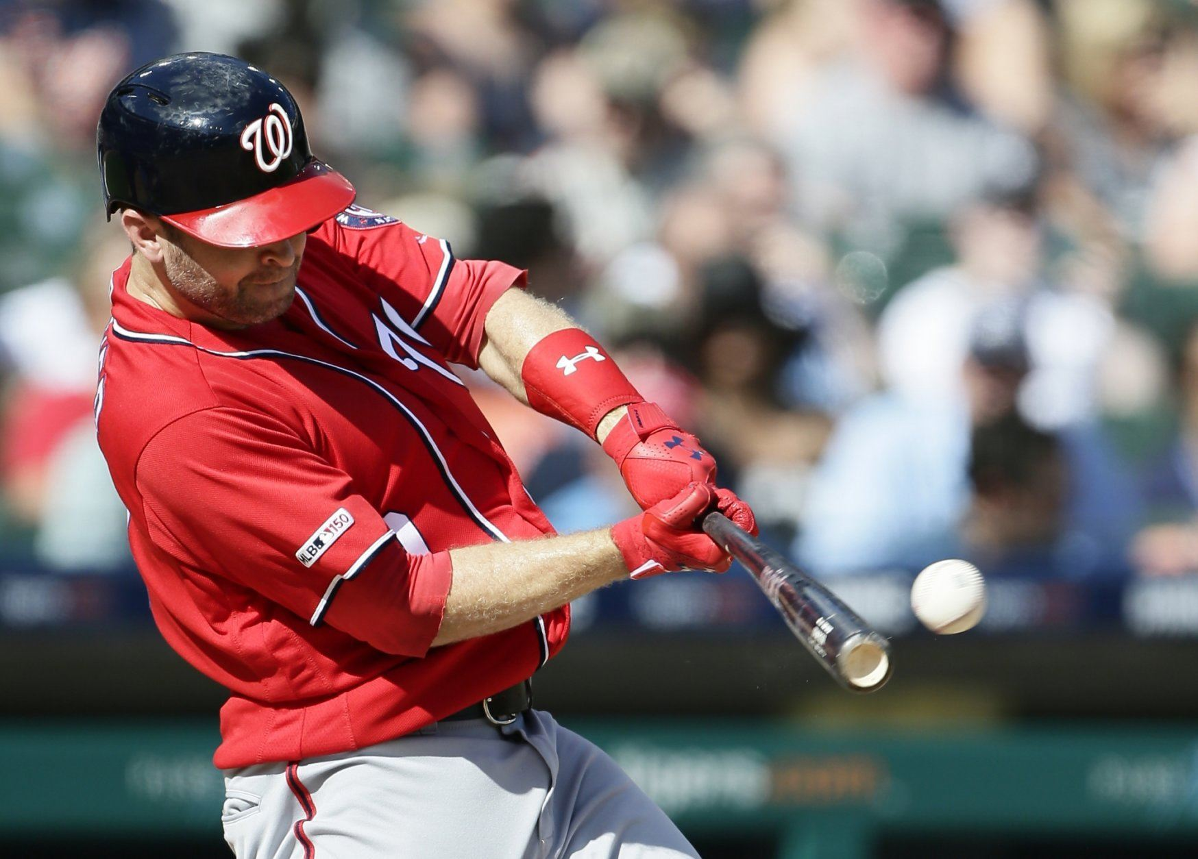 Washington Nationals' Brian Dozier doubles to drive in teammate Juan Soto against the Detroit Tigers during the fourth inning of a baseball game Saturday, June 29, 2019, in Detroit. (AP Photo/Duane Burleson)
