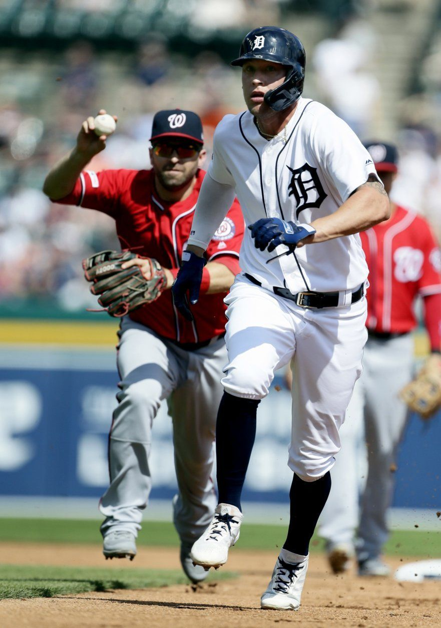 Detroit Tigers' JaCoby Jones, right, is pursued by Washington Nationals' Brian Dozier after getting caught in a rundown between first base and second during the first inning of a baseball game Saturday, June 29, 2019, in Detroit. Nationals pitcher Austin Voth eventually made the tag. (AP Photo/Duane Burleson)
