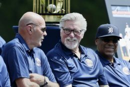 Former Detroit Tiger Kirk Gibson, left, chats with Jack Morris and Lou Whitaker during the 35th anniversary celebration of their 1984 World Series championship before a baseball game against the Washington Nationals Saturday, June 29, 2019, in Detroit. (AP Photo/Duane Burleson)