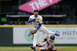 Baltimore Orioles' Keon Broxton is forces out at second as Seattle Mariners shortstop J.P. Crawford throws to first to complete a double play on Richie Martin during the second inning of a baseball game, Sunday, June 23, 2019, in Seattle. (AP Photo/John Froschauer)