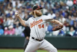 Baltimore Orioles pitcher Andrew Cashner throws to a Seattle Mariners batter during the first inning of a baseball game Saturday, June 22, 2019, in Seattle. (AP Photo/Joe Nicholson)