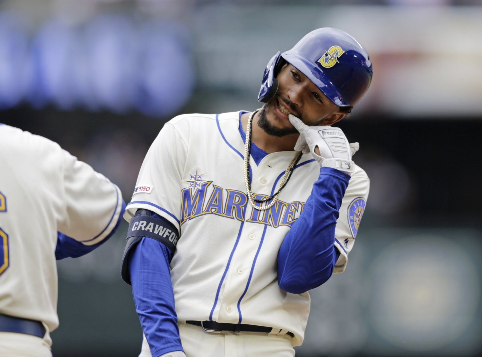 Seattle Mariners' J.P. Crawford reacts on first after hitting a two-run single against the Baltimore Orioles during the third inning of a baseball game, Sunday, June 23, 2019, in Seattle. (AP Photo/John Froschauer)
