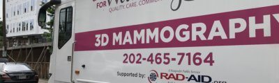 Breast Care for Washington, a group that aims to provide screening and care to underserved D.C. populations, rolled out the MobileMammo program at an event Wednesday. It will provide 3D mammograms aboard a 45-foot bus. (WTOP/Kristi King)