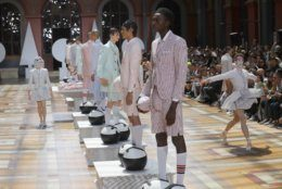Models wear creations for the Thom Browne mens Spring-Summer 2020 fashion collection presented in Paris, Saturday, June 22 2019. (AP Photo/Michel Euler)