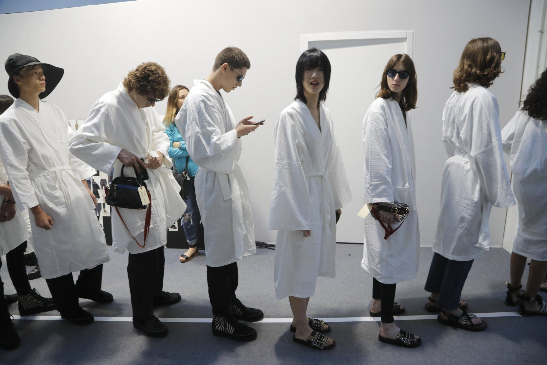 Models wait backstage prior to the Sacai mens Spring-Summer 2020 fashion collection presented in Paris, Saturday, June 22 2019. (AP Photo/Michel Euler)