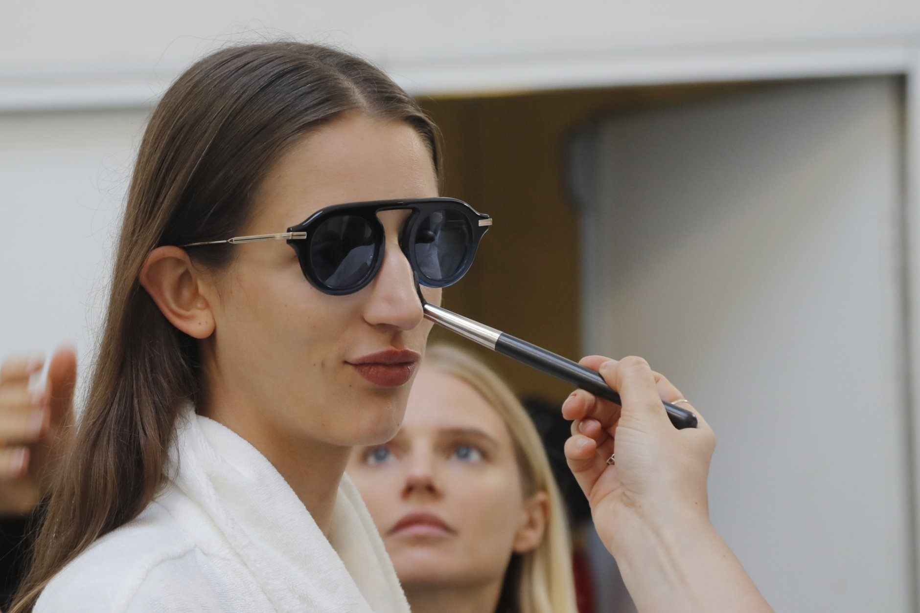 A model is made up backstage prior to the Sacai mens Spring-Summer 2020 fashion collection presented in Paris, Saturday, June 22 2019. (AP Photo/Michel Euler)