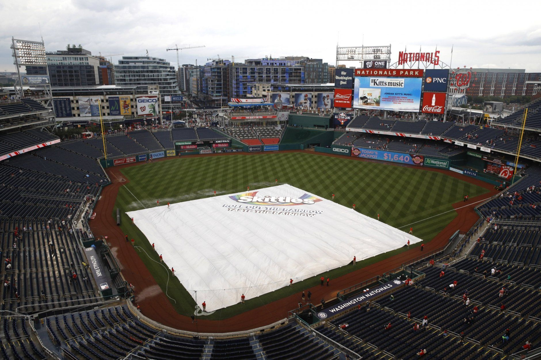 A tarp covers the infield during a rain delay before a baseball game between the Philadelphia Phillies and the Washington Nationals, Monday, June 17, 2019, in Washington. (AP Photo/Patrick Semansky)