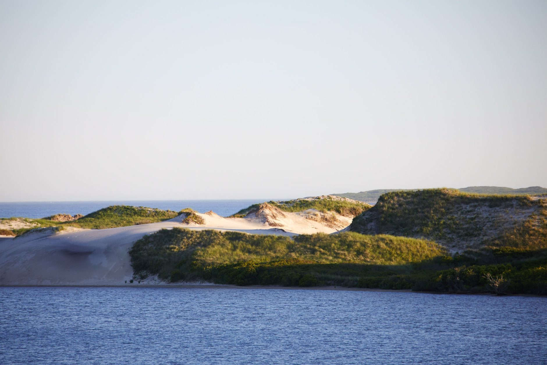 When Mrs. Onassis purchased the Aquinnah property in 1979, she was drawn to the untamed beauty of the oceanfront property's coastal dunes, freshwater ponds, and the abundance of plants, trees, birds and other wildlife, and she fiercely protected it, as has her daughter Caroline Kennedy in the years since. (Laura Moss Photography)