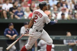 Boston Red Sox's Xander Bogaerts follows through on an RBI-triple against the in the sixth inning of a baseball game against the Baltimore Oriloes, Saturday, June 15, 2019, in Baltimore. (AP Photo/Gail Burton)