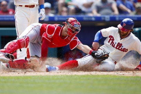 Reds avoid sweep, rally in 7th to top Phillies 4-3