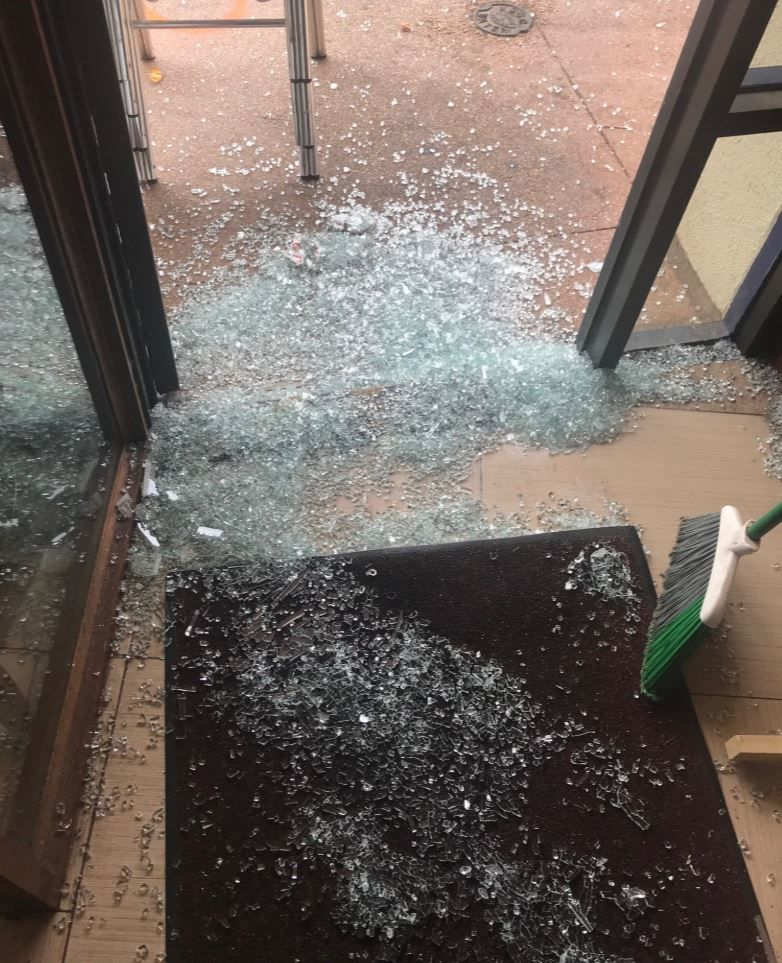 The suspects smashed the glass front doors on all three shops to gain entry into to the businesses in the shopping center that's located on the edge of Rock Creek Park. (WTOP/Dick Uliano)