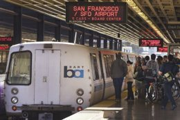 FILE - In this Oct. 15, 2013, file photo, passengers board a Bay Area Rapid Transit train in Oakland, Calif. The agency that runs San Francisco's Bay Area Rapid Transit system says the rate of aggravated assaults on trains and platforms has increased, while overall violent crimes went down this year. The San Francisco Chronicle quotes BART Police Chief Carlos Roja citing a slight but encouraging downward trend in crime as the agency released statistics from the first third of 2018. (AP Photo/Ben Margot, File)