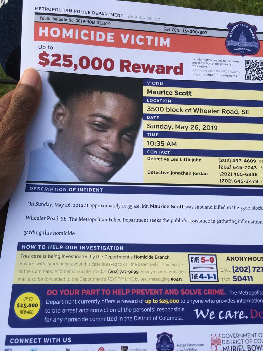 D.C. police have set a $25,000 reward for information that leads to a break in Scott's case. Scott's family passed these fliers out at his vigil. (WTOP/Liz Anderson)