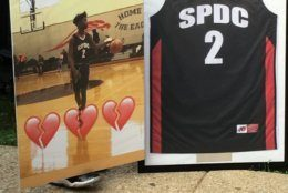 Scott's basketball jersey was framed and brought to the vigil. (WTOP/Liz Anderson)