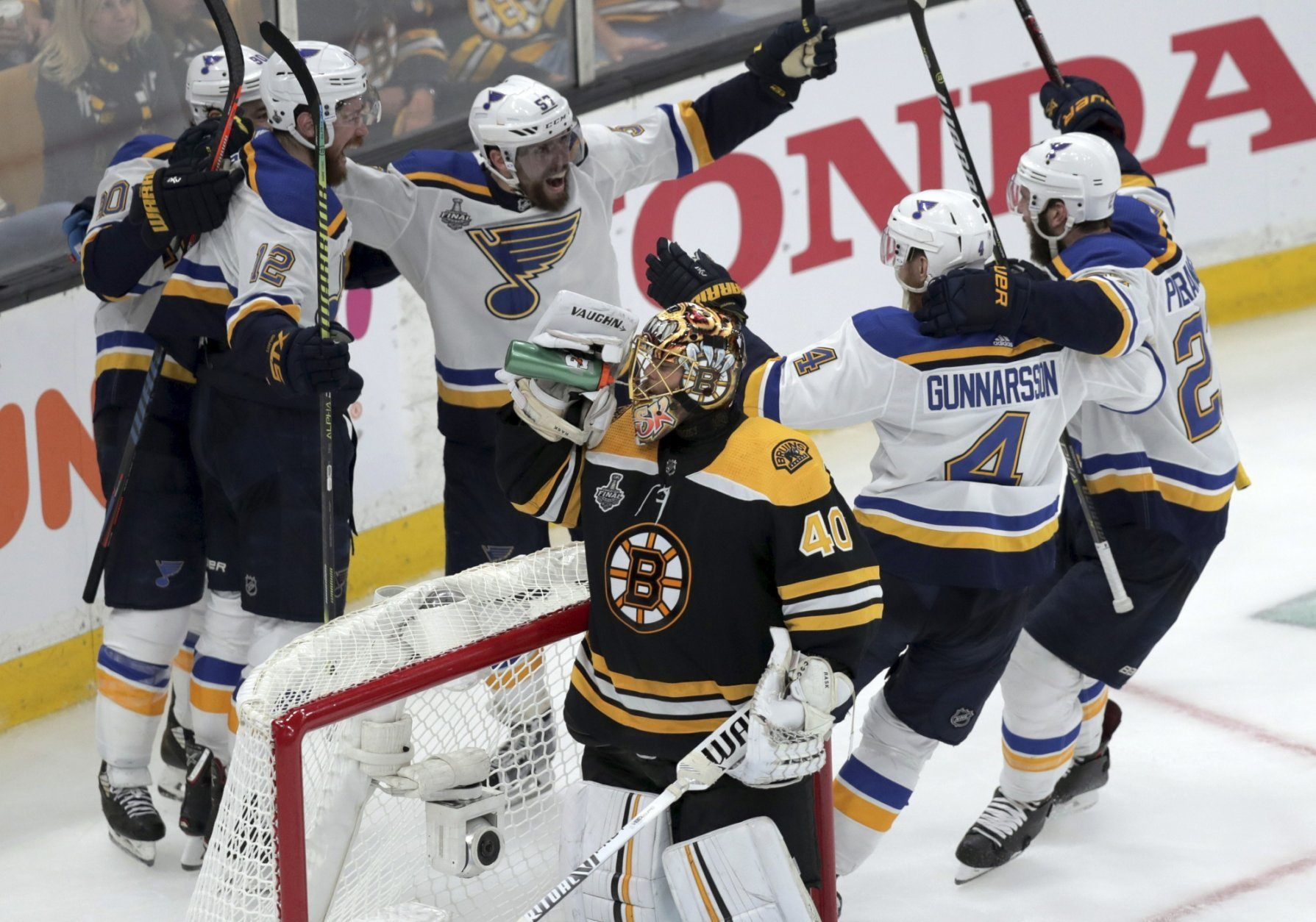 St. Louis Blues' Zach Sanford (12) celebrates his goal with teammates behind Boston Bruins goaltender Tuukka Rask (40), of Finland, during the third period in Game 7 of the NHL hockey Stanley Cup Final, Wednesday, June 12, 2019, in Boston. (AP Photo/Charles Krupa)