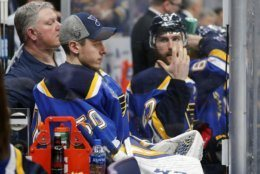 St. Louis Blues goaltender Jordan Binnington (50) sits on the bench after being removed from the game during Game 3 of the NHL hockey Stanley Cup Final against the Boston Bruins Saturday, June 1, 2019, in St. Louis. (AP Photo/Jeff Roberson)